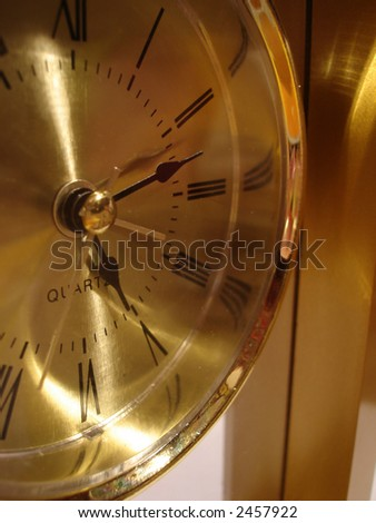 closeup of golden clock - stock photo