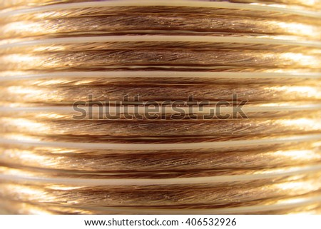 Closeup of golden coiled speaker wire - abstract concept - stock photo