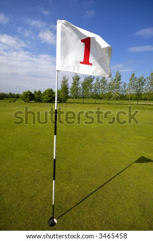 closeup of golf flag number one. - stock photo
