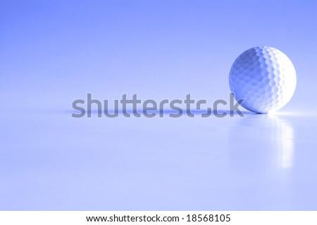 Closeup of golfball with dark shadows - stock photo