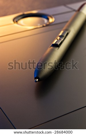 closeup of graphic tablet  with pen - stock photo