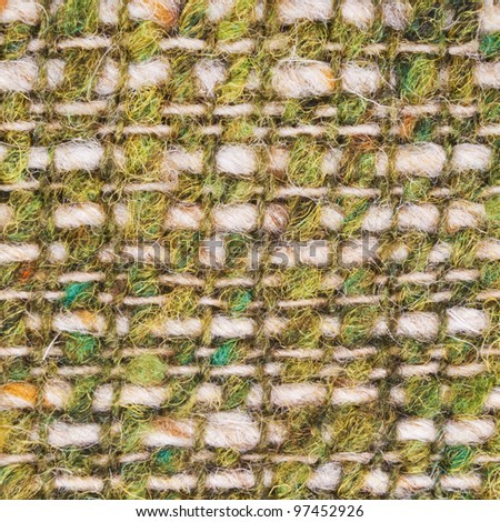 Closeup of green and yellow wool texture - stock photo