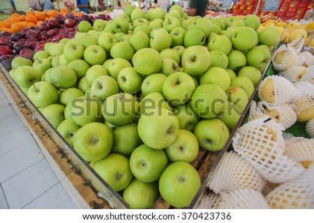 Closeup of green apples on a market