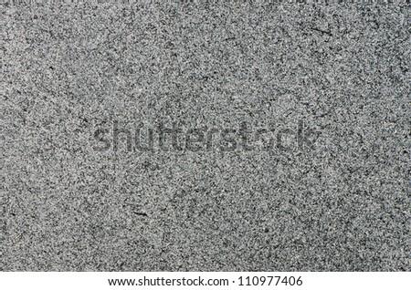 Closeup of grey granite texture background. - stock photo