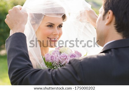 Closeup Of Groom Looking At Bride During the Wedding Ceremony - stock photo
