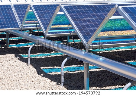 Closeup of ground level solar panels with photovoltaic grid  - stock photo