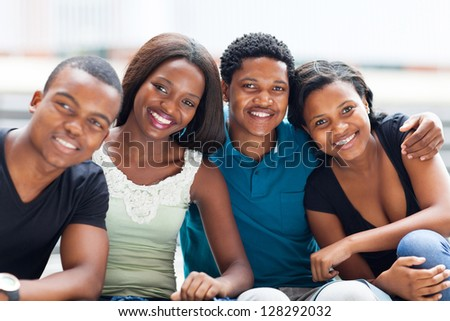 closeup of group of african american college friends outdoors - stock photo