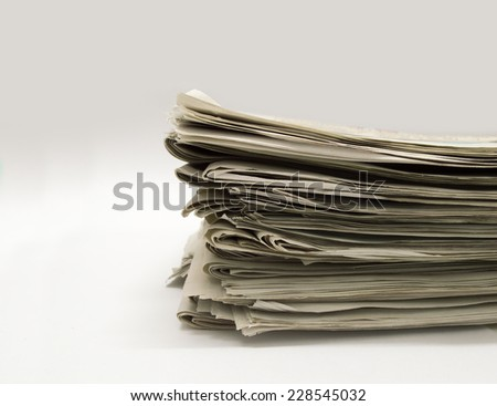 closeup of group of newspapers on a white background  - stock photo