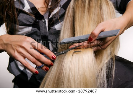 closeup of hairdresser doing haircut - stock photo