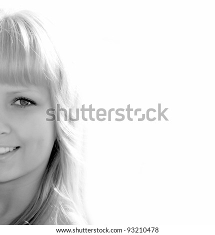 Closeup of half face beautiful girl isolated on white in black and white style - stock photo