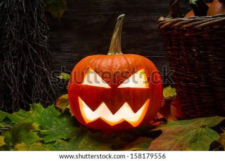 Closeup of halloween pumpkin on autumn leaves - stock photo