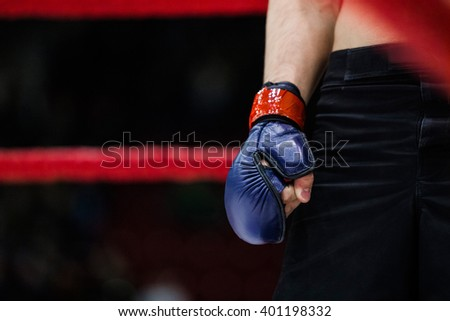 closeup of hand boxer in glove stood in corner of ring - stock photo