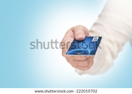 closeup of hand hold blue credit card. focus on card. showing blue credit card - stock photo