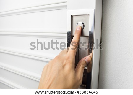 Closeup Of Hand Pushing The Button To Open The Garage Door