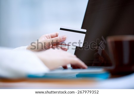 Closeup of hand with blank card - stock photo