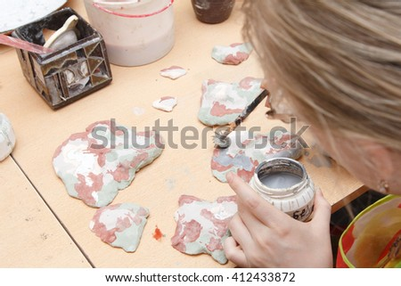 Closeup of hands making pottery craft - stock photo