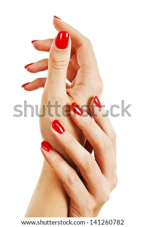 Closeup of hands of a young woman with long red manicure on nails. Isolated on white background - stock photo