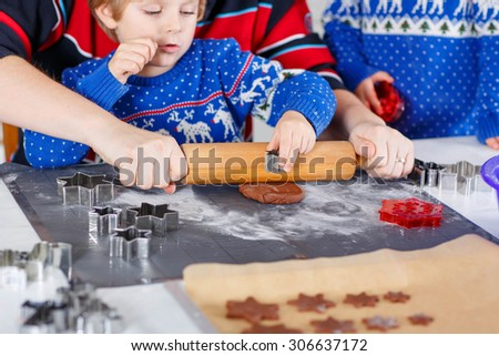 Closeup of hands of adult and kids with baking of gingerbread cookies. Family, holiday, kids lifestyle concept. - stock photo