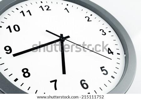 Closeup of hands on clock face - stock photo