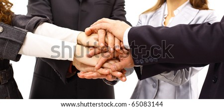 Closeup of hands on top of each other - stock photo