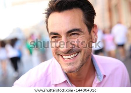 Closeup of handsome guy wearing pink shirt - stock photo