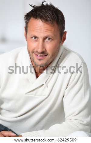 Closeup of handsome man with white sweater - stock photo