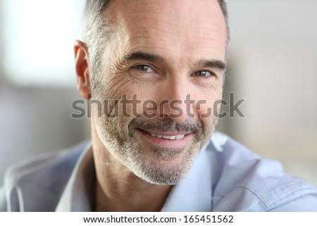 Closeup of handsome senior man with grey hair - stock photo