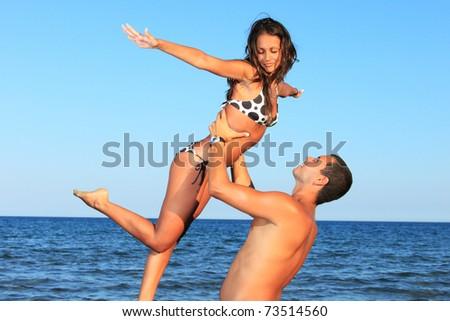 Closeup of happy couple at the beach - stock photo