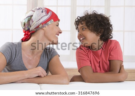 Closeup of happy  mother and son  - stock photo