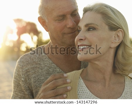 Closeup of happy senior couple spending quality time on tropical beach - stock photo
