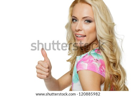Closeup of happy woman showing thumbs up gesture on white background
