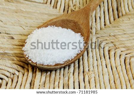 Closeup of Healthy Sea Salt on bamboo background - stock photo