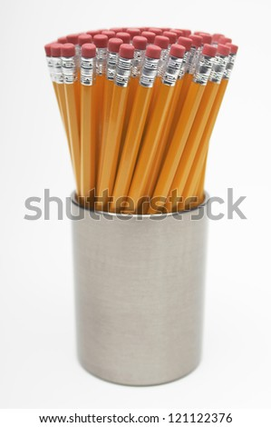 Closeup of holder with group of pencils isolated over white background - stock photo