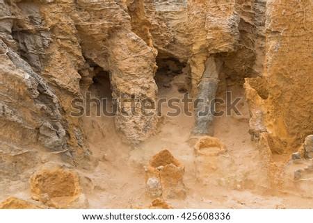 Closeup of hollow tubes of limestone, petrified trunk rocks at Petrified Forest Walk, Cape Bridgewater in Victoria, Australia - stock photo