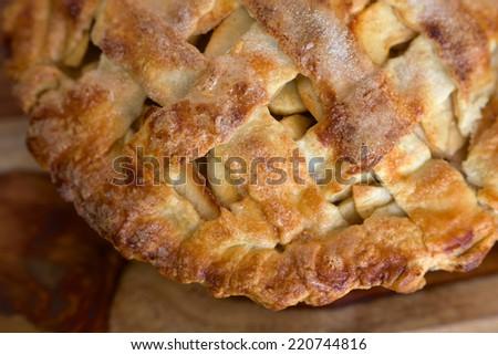 Closeup of homemade apple pie lattice crust - stock photo