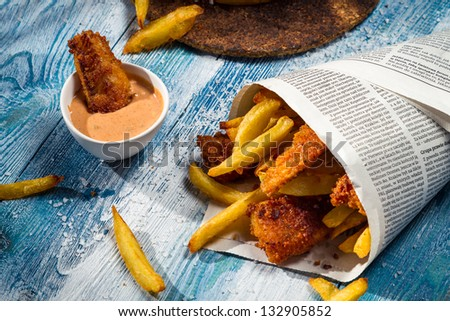Closeup of homemade Fish & Chips in newspaper - stock photo