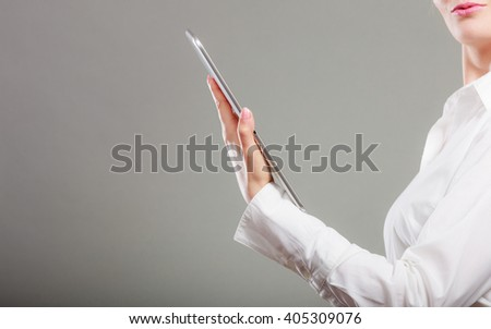 Closeup of human reading and learning with ebook digital tablet studying for exam. Education leisure.