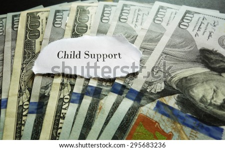 Closeup of hundred dollar bills with Child Support note - stock photo