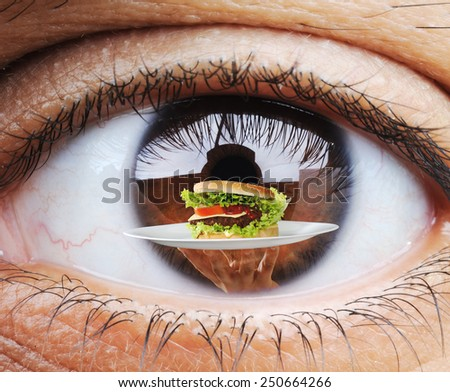 Closeup of hungry human eye macro mode with double exposure and fast food burger in - stock photo