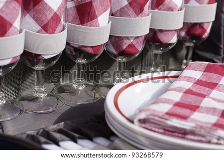 Closeup of inside picnic basket with red and white gingham - stock photo
