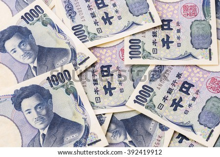Closeup of Japanese currency yen bank notes - stock photo