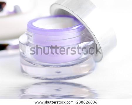 Closeup of jar of moisturizing face cream. Open container of cream. - stock photo