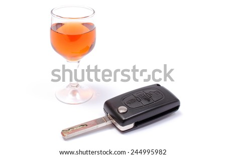 Closeup of key car with glass of wine, key car and alcohol, don't drink and drive concept. Isolated on white background - stock photo
