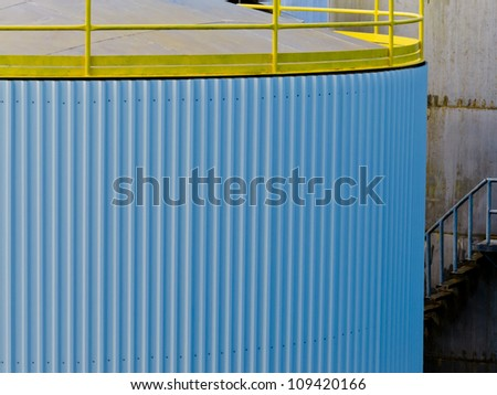 Closeup of large steel storage tank at a refinery terminal used for storage and distribution of petrochemical products - stock photo