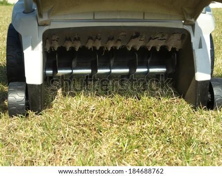 Closeup of lawn scarifier back showing scarifying mechanism  - stock photo