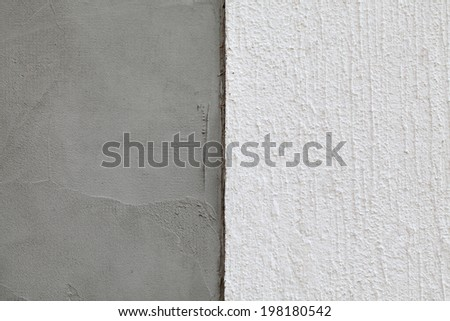 Closeup of layers over styrofoam insulation, plaster, cement, mortar - stock photo