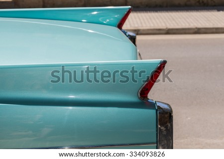 Closeup of legendary classic car in retro turquoise color.  Vintage automobile American 50s style, extravagant tail lights - stock photo