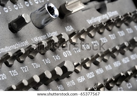 Closeup of lines of screwdriver heads in a workman's toolbox - stock photo