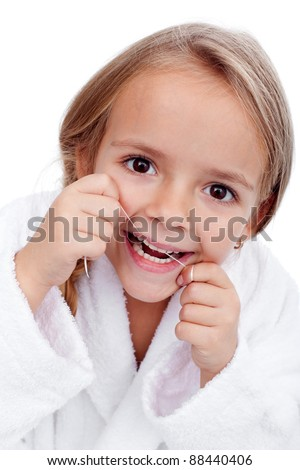 Closeup of little girl flossing her teeth - oral hygiene concept