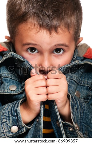 Closeup of little poor boy getting cold - stock photo
